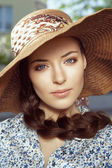 Close-up portrait of woman in hat — Stock Photo