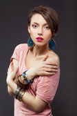 Beautiful young woman with makeup — Stock Photo