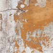 Badly damaged plaster wall background — Stockfoto #12030178