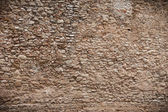 Texture de mur en pierre très ancienne. bordé de noir — Photo