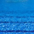 Blue water surface background in pool — Stock Photo #12105301