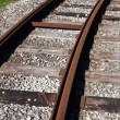 Tram rail road track disappearing around a curve — Stock Photo