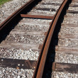 Tram rail road track disappearing around a curve — Stock Photo #12105313
