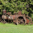 Old rusty farming tractor — Stock Photo
