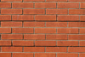 Simple orange brick wall — Stock Photo