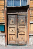 Old door and window of wooden building — Stock Photo