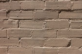 Yellow paint brick wall background — Stock Photo