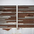 Old metal rusty ventilation windows on wall — Stock Photo
