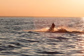 Young guy cruising in the baltic sea on a jet ski — Stock Photo