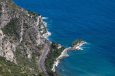 French Riviera with windy mountain road — Stock Photo