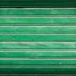 Green painted wooden background — Stock Photo