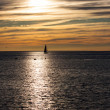 Stock Photo: Sailing boats on beautiful sunset