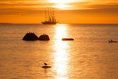 Schooner silhouette at sunset — Stock Photo
