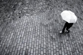 Woman with umbrella in rain — Stock Photo