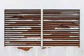 Rusty ventilation windows on wall — Stock Photo