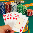 Royal flush cards holding in hand — Stock Photo