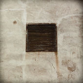 Metal rusty ventilation window on wall — Stock fotografie
