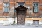 Old door and window of wooden house — Stock Photo