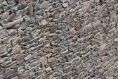Wall of slate, very typical Mediterranean construction — Stock Photo