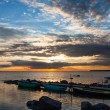 Peaceful sunset dramatic sky and boats — Stock Photo