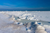 Frozen winter sea under snow during sunny day — Stok fotoğraf