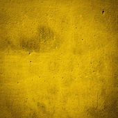 Yellow damaged plaster background — Stock Photo