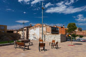 Resting benches on the square in Spanish village — Stock Photo