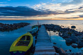 Peaceful sea sunset and pier boats — Stock Photo