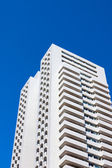 Modern residential building on blue sky — 图库照片