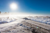Winter landscape at fog with road — Stock Photo