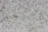 Texture of wet gravel road — Stock Photo