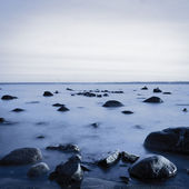 Rocky coast in the evening. Long exposure shot — Stock Photo
