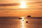 A cruise ship near the coast during sunset — Stock Photo