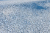 Texture of white snow with blue shadows — Stock Photo