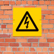 Yellow Danger of Death Warning sign on a brick wall — Stock Photo