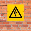 Yellow Danger of Death Warning sign on a brick wall — Stock Photo #21232013