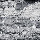 Cracked plaster stone wall — Stock Photo