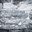 Cracked scratched plaster stone wall  — Stock Photo