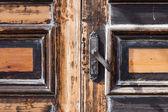 Door handles of input,closed and locked old door — Stock Photo