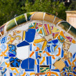Detail closeup of mosaic in Park Guell, Barcelona - Stock Photo