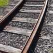 Railway rail road track disappearing around a curve — Stock Photo