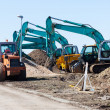 Excavators and asphalt compactor truck — Stock Photo