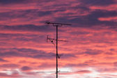 Silhouettes of antennas with sunset — Stock Photo