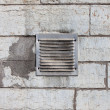 Stock Photo: Metal ventilation window on wall background wall background