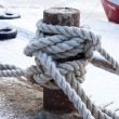 Old bollard and frozen ship cable  — Stock Photo