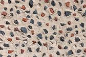 Decorative stone wall and beautiful beach theme background — Stock Photo