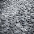Closeup background texture of cobblestone road — Stock Photo