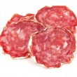 Pile of salchichon, red spanish salami, on a white — Stock Photo