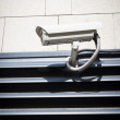 Security camera on the wall — Stock Photo