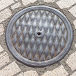 Stock Photo: Pavement & hatch sewer manhole